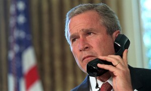 Pledging his support, President George W. Bush talks via telephone Thursday, Sept. 13, 2001, to New York Gov. George Pataki and New York City Mayor Rudolph Giuliani.  Photo by Eric Draper, Courtesy of the George W. Bush Presidential Library